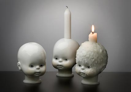 Baby head candle holder